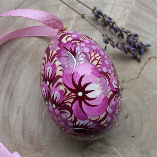 Hand painted wooden Easter egg with butterfly in purple