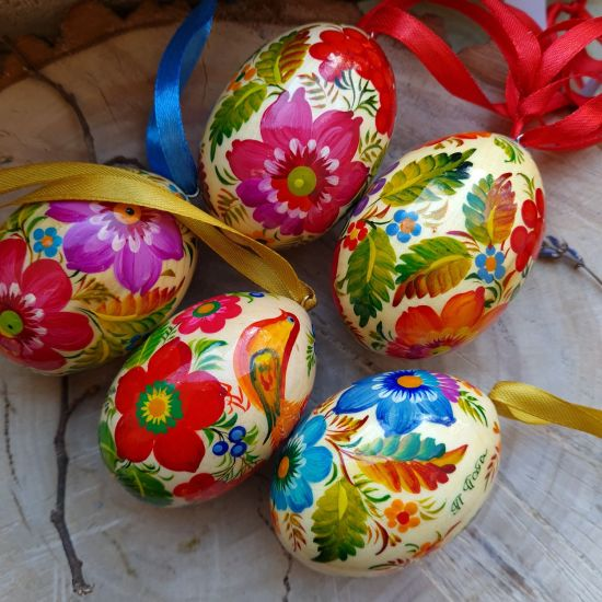 Ukrainian traditional Easter wooden eggs to hang, painted with bird motive