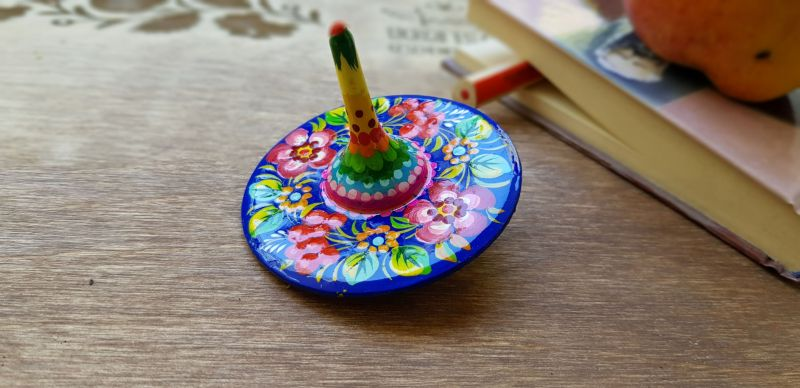 Wooden spinning top, eco toy with traditional ukrainian painting
