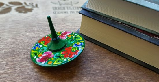 Spinning top, traditional wooden toy with flowers patterns, hand painted in Ukraine