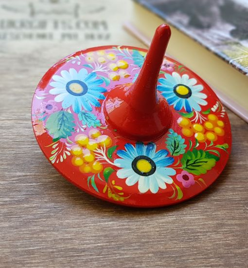 Spinning top, traditional wooden toy with flowers patterns, hand painted