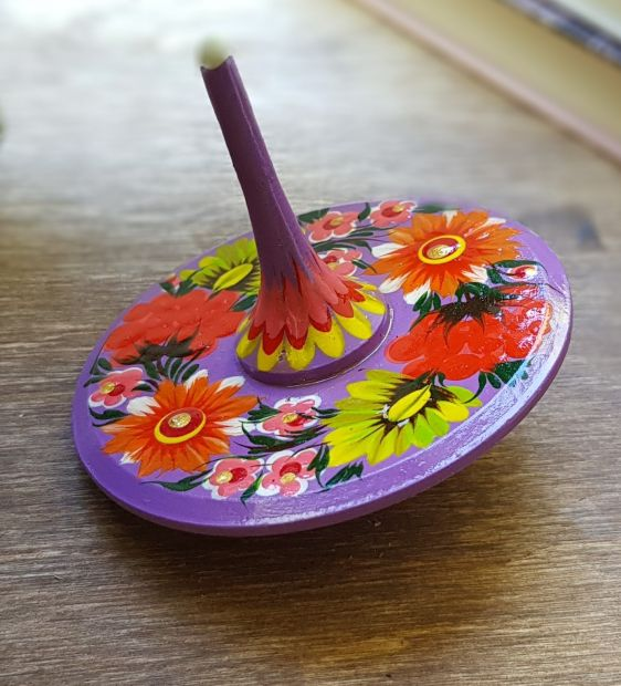 Handmade wooden spinning top, eco toy with traditional ukrainian painting