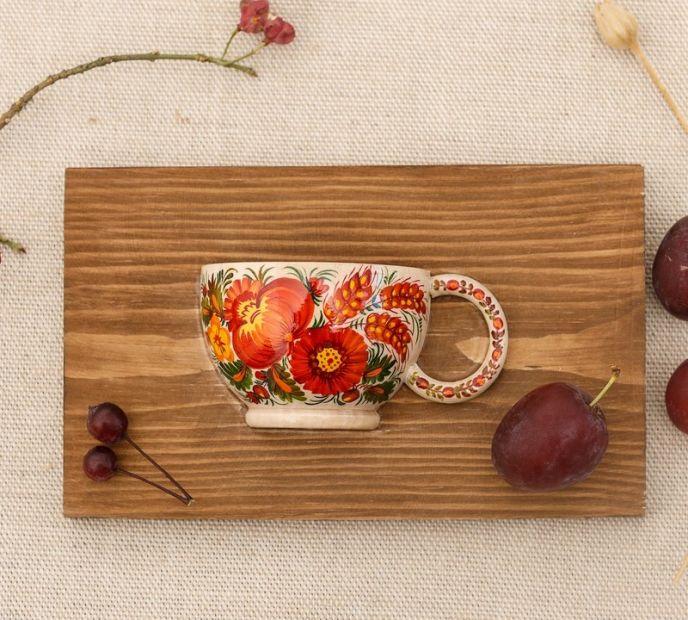 Folklore Wanddeko aus Holz, kleine Tasse mit Blumenmuster