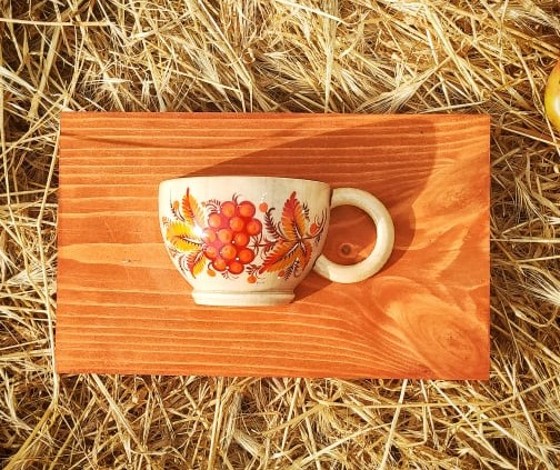 Rustic wooden wall deco, small cup with orange flowers