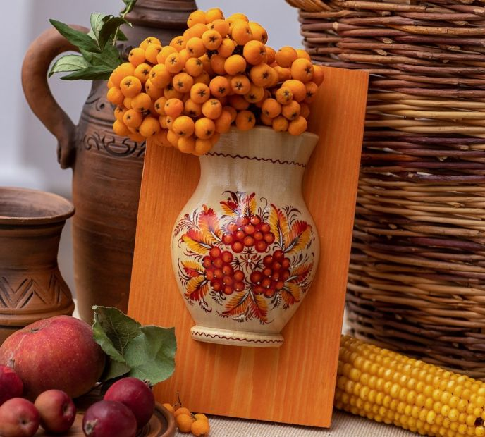 Rustic wooden wall deco, small vase with orange flowers