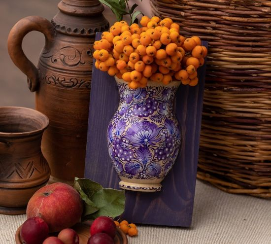 Wooden wall decor like small vase for dry flowers