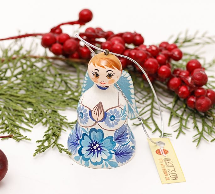 Christmas angel and bell made of wood, white and blue