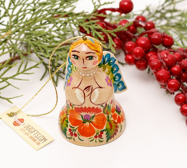 Wooden christmas bell in the shape of angel with small wings