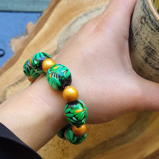 Wooden beaded bracelet with -green and gold, handmade folk wooden jewelry